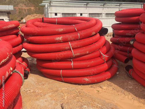Photo SEREMBAN, MALAYSIA -APRIL 06, 2019: HDPE corrugated pipe stored in open space at the construction site