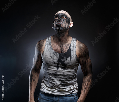 Photo of bald man with black goo in the mouth Canvas Print