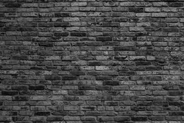 Black brick wall. Loft interior design. Architectural background.
