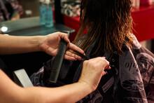 A Close-up Of A Hairdresser Cu...
