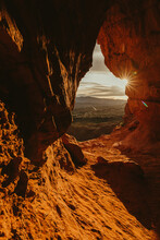 Sunset View Over St. George Utah From Inside An Orange Cave