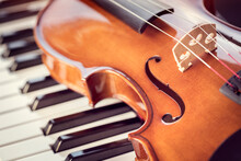 Violin On Top Of Piano Keys  Background