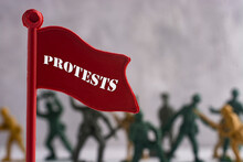 Figures Of Protesting People A...