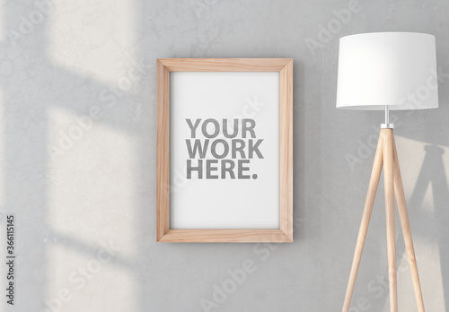 Fototapeta Vertical Wooden Frame Mockup Hanging on Wall with Floor Lamp obraz