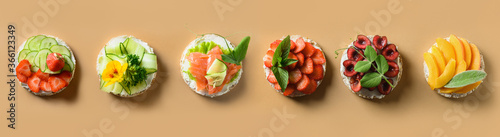 Cuadros en Lienzo Rice cakes with different types garnish fruits, vegetables, microgreens on natural beige background