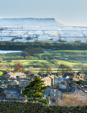 Askrigg Village And Snow Capped Addlebrough In Upper Wensleydale, The Yorkshire Dales, Yorkshire