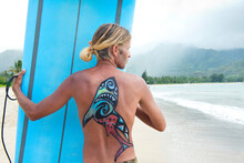 Surfer In Hanalei Bay, With A Shark Painted On His Back, Kauai, Hawaii