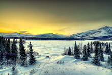 Sunrise Over The Frozen Otto Lake And Snowy Mountains Of Denali National Park In The Background, Alaska