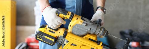 Fototapeta Builder holding perforator instrument in hand obraz