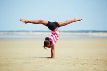 Black Girl Doing Handstand On ...
