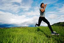 Black Athlete Running In Rural...