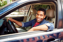 Smiling Man Posing In Car Window