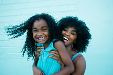 Portrait Of Black Mother And D...