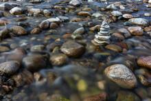 USA, Idaho, Sun Valley, Rock Stack Among River Rocks
