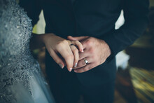 Close Up Of Hands Of Bride And...