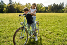 Siblings Enjoying Bicycle Ride...