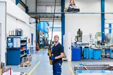 Man Working With Indoor Crane ...