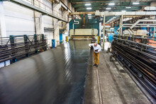 Senior Businessman In A Rubber Processing Factory Examining Product