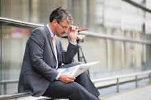 Businessman Wearing Eyeglasses...