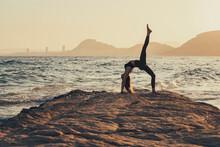 Mature Woman Practicing Yoga A...