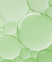 Three Dimensional Render Of Transparent Glass Spheres Against Green Background