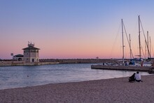 Romantic Sunset At The Port Of Ostia, A Lighthouse, Some Boats  And A Charming Colorful Sky At Sundown.; Maritime Panorama That Inspires Calm And Tranquility In A Hug Of Love