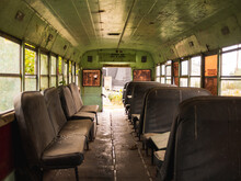 Inside An Abandoned School Bus With The Seats