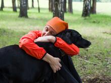 A Woman Hugs Her Beloved Dog I...