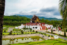 Chiang Mai, Thailand - July 20, 2020: Royal Flora Rajapruek, Royal Pavilion, Beautiful Mahogany And Gilding Temple, Folded Roof, Beautiful Park And Pond, Daytime, In Cloudy Weather