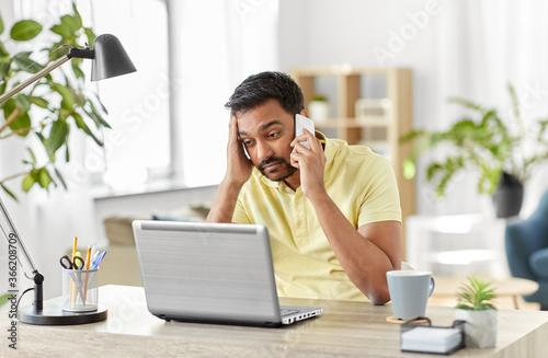 Obraz na plátně technology, communication and remote job concept - indian man calling on smartph