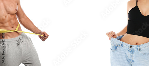 Obraz Man and woman with slim bodies on white background, closeup. Banner design - fototapety do salonu