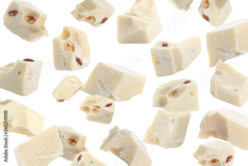 Fotomural Delicious chocolate chunks falling on white background