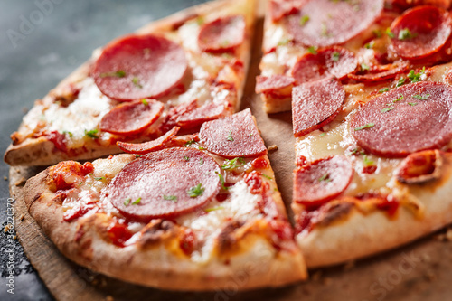 Traditional Italian salami pizza in close up