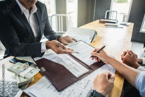 фотографія Customer signing contract documents for realty purchase, Bank employees congratulate, Concept mortgage loan approval