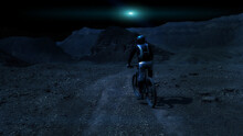 Cyclist In The Night Desert An...