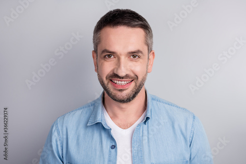 Fototapeta Close-up portrait of his he nice attractive content successful cheerful cheery guy beaming smile healthy teeth isolated over gray light pastel color background obraz na płótnie