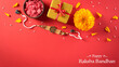 canvas print picture - Raksha Bandhan, Indian festival with beautiful Rakhi and  Rice Grains on red background.  A traditional Indian wrist band which is a symbol of love between Sisters and Brothers.