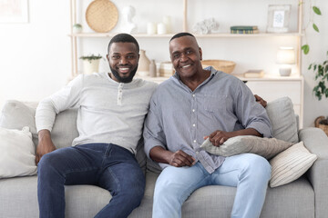 Obraz na płótnie Canvas Portrait With Dad. Happy Black Man Posing With Mature Father At Home