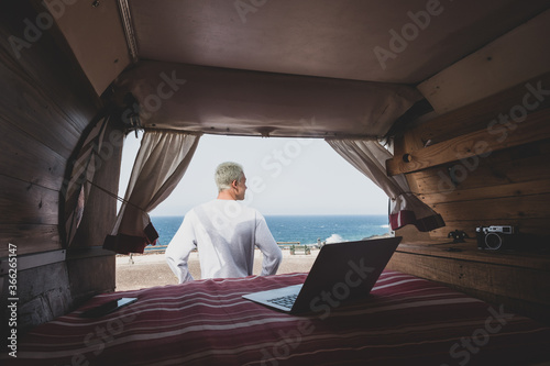 Fotomural one man alone isolated from the society with his minivan camper traveling and en