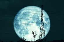 Super Blue Worm Moon And Silhouette Power Electric Pole And Night Sky