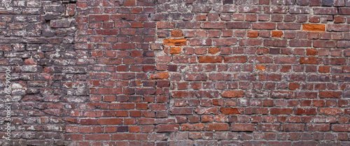 background of old red brick wall. Texture of grunge brickwork Fototapeta