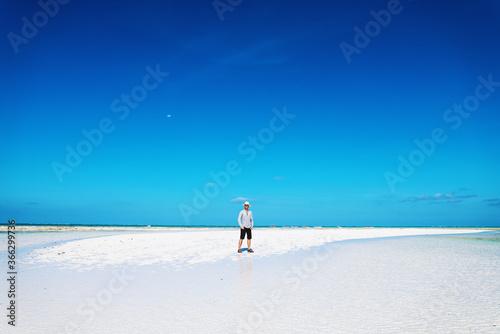 Man walking on sand bank