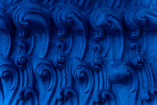 A Bas-relief Element In The Form Of Sea Waves At The Base Of The Buddha Statue In A Buddhist Temple. Abstract Indigo Background. Blue Ocean Waves.
