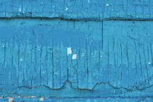 The Texture Of The Old Cracked Painted Many Times Over Blue Wood