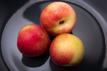 Apricots, Peaches And Nectarines On A Black Plate Close-up