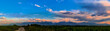 canvas print picture - Panorama of a mountain valley in the summer, cloudy sky. Fairytale sunset over the mountain peaks, amazing nature, summer in the mountains. Travel. beautiful background picture of nature