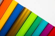Colorful Vinyl Rolls On Wooden Background