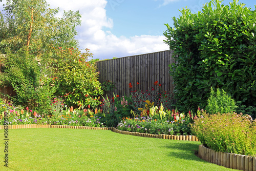 Tablou Canvas Colourful flowers and shrubs in a pretty garden.