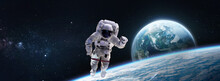 Astronaut In The Outer Space Near Earth Planet Surface. Abstract Wallpaper. Spaceman. Elements Of This Image Furnished By NASA