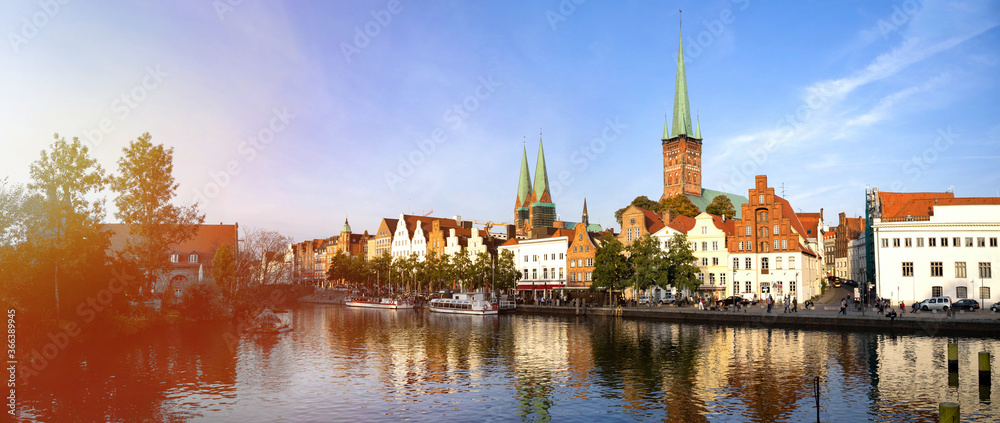 Fototapeta Skyline of the historic city of Luebeck with Trave river in summer, Schleswig-Holstein, Germany